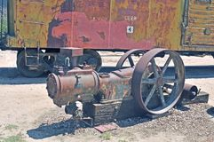 Vintage Dual Belt Drive Air Compressor. This vintage air compressor was likely powered by a steam or gasoline engine using dual drive belts to transfer the power Royalty Free Stock Photo