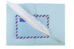 Vintage air mail envelope with antique quill Royalty Free Stock Image