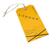 Vintage airline luggage label. Vintage yellow airline luggage label tagged London. Used in 1948. Isolated on white Stock Photos