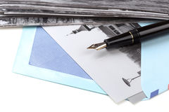 Vintage airmail envelope and fountain pen Stock Photos