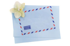 Vintage airmail envelope with orchid. Over white background Stock Photography