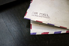 Vintage Airmail Envelope. On wood table Royalty Free Stock Images