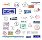 Vintage airmail labels and stamps. Vintage postage stamps and airmail labels from all over the world Royalty Free Stock Photos
