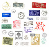 Vintage airmail labels and stamps. Vintage postage stamps and airmail labels from all over the world Stock Photography