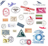 Vintage airmail labels and stamps. Vintage postage stamps and airmail labels from all over the world Stock Photos