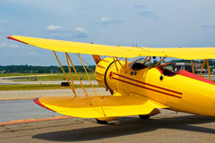 Vintage airplane. Yellow vintage airplane at the airport Royalty Free Stock Images