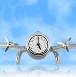 Vintage Airplane Desk Clock. Airplane Desk Clock against Blue Sky with reflection; Concept: Time Flies; Clipping Path stock photography