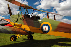 Vintage airplane parked on the grass Royalty Free Stock Photo