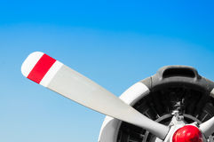 A Vintage airplane propeller with radial engine on blue sky Royalty Free Stock Photos