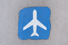 Vintage airplane sign on the ground Royalty Free Stock Photography