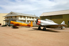 Vintage Airplanes. Two vintage airplanes parked at their hangers located at Pima Air Park Museum in Tucson Arizona stock photo