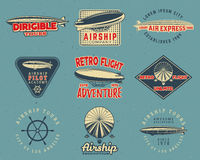 Vintage airship logo designs set. Retro Dirigible badges collection. Airplane Label vector design. Old airship design Royalty Free Stock Photo