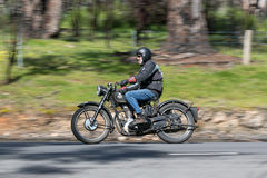 Vintage AJS Motorcycle on country road. Adelaide, Australia - September 25, 2016: Vintage AJS Motorcycle on country roads near the town of Birdwood, South Royalty Free Stock Photos