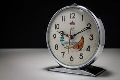 Vintage alarm clock. On a white surface and black background Royalty Free Stock Images