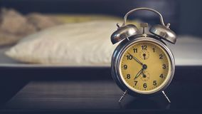 Vintage alarm clock in bedroom Stock Photos