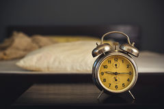 Vintage alarm clock in bedroom Royalty Free Stock Photos