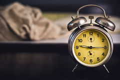 Vintage alarm clock in bedroom Stock Images