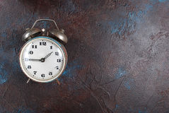 Vintage alarm clock on the brown background Royalty Free Stock Photography