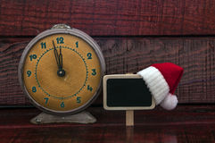 Vintage alarm clock and christmas decoration Stock Photos
