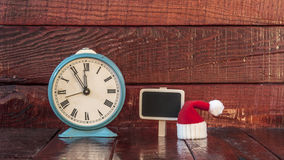 Vintage alarm clock and christmas decoration Royalty Free Stock Image