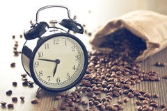 Vintage alarm clock and coffee beans Stock Photo