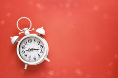 Vintage alarm clock with copy space on red  background. Royalty Free Stock Photo