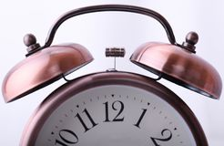 Vintage alarm clock with focused on hammer Royalty Free Stock Photos