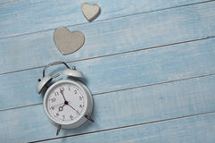 Vintage alarm clock with handmade wooden heart Stock Images