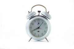 Vintage alarm clock isolated on a white Royalty Free Stock Photo