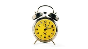 Vintage alarm clock making a twelve hours full turn Royalty Free Stock Images