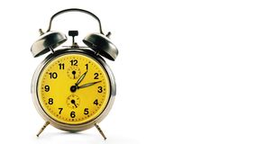 Vintage alarm clock over a white background making a twelve hours full turn stock footage