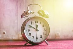 Vintage alarm clock on a red white background, toning royalty free stock images
