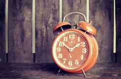 Vintage alarm clock. Shot on a old wood background Royalty Free Stock Images