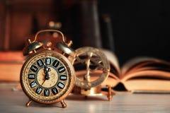Vintage Alarm Clock Showing Five To Twelve Stock Photo