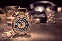 Vintage alarm clock showing five to twelve. Happy New Year 2015! Royalty Free Stock Photo