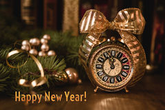 Vintage alarm clock showing five to twelve. Happy New Year! Royalty Free Stock Photo