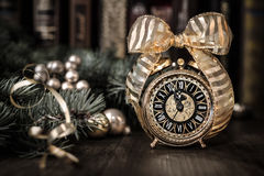 Vintage alarm clock showing five to twelve. Happy New Year 2015! Stock Photos