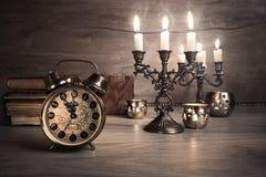 Vintage alarm clock showing five to twelve Stock Image