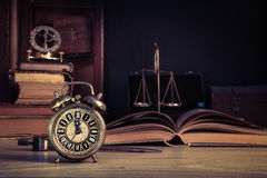 Vintage alarm clock showing five to twelve Royalty Free Stock Images