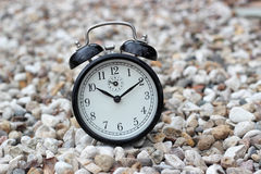 Vintage alarm clock on stones Stock Photos