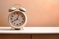Vintage alarm clock on a table Stock Photos