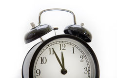 Vintage alarm clock on a white background Stock Photography