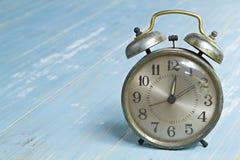 Vintage alarm clock wooden background Royalty Free Stock Photos