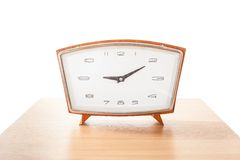 Vintage alarm clock on a wooden table Royalty Free Stock Photography