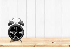Vintage alarm clock on wooden table Stock Image