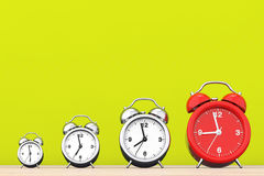 Vintage Alarm Clocks with Single Red One.  3d Rendering Royalty Free Stock Photography