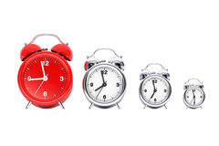 Vintage Alarm Clocks with Single Red One.  3d Rendering Stock Photos