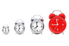 Vintage Alarm Clocks with Single Red One.  3d Rendering Royalty Free Stock Photos