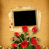 Vintage album for photos with a bouquet of red roses and tul Stock Images