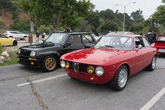 Vintage Alfa Romeo GTV and Renault 5 Turbo Gr4 Bozian on display Royalty Free Stock Images